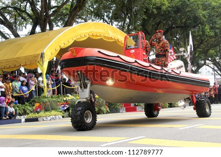 KUANTAN, MALAYSIA - AUG 31: Malaysia fire rescue boat taking part in National Day, celebrated the 55th anniversary Independence on 31 August 2012 in Kuantan, Pahang, Malaysia