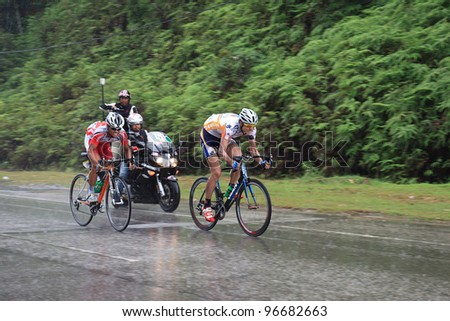 KUANTAN-MARCH 2: Hao Liu (MAX Success Sports) & Wijaya Endra (Indonesia Team) in action during Stage 8 of the le Tour de Langkawi from Bentong to Kuantan on March 2, 2012 in Kuantan, Pahang, Malaysia.
