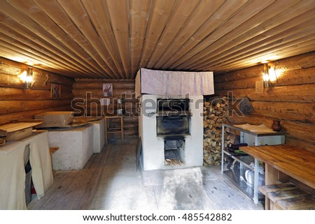 "KUBINKA, MOSCOW OBLAST, RUSSIA - JUL 04, 2016: Military-patriotic park ""Patriot"". Reconstruction of a partisan village of the WWII - Bakery (dugout) #485542882"
