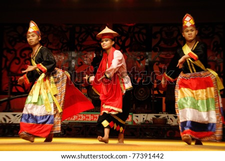 KUCHING, MALAYSIA - MAY 14: Artists from the indigenous Bidayuh people perform a traditional dance at the Sarawak Cultural Village, May14, 2010 in Kuching. The Bidayuh are gentle and friendly natives from Borneo.