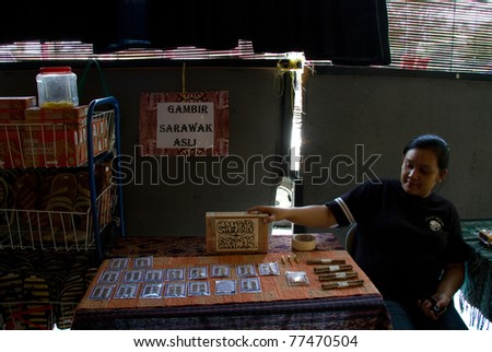 KUCHING - MAY 13: An unidentified lady sells 'gambir' waits for customers at her stall May 13, 2011 in Kuching, Borneo Island. Gambir is used as a sex stimulant and other medicinal uses by the natives - stock photo