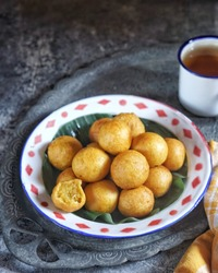 Kue Bola-bola Ubi. Tradisional snacks from Indonesia.  Made from sweet potatoes, wheat flour and sugar, kneaded and shaped like a ball then fried.  Served with a cup of tea or coffee.