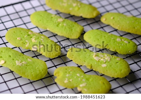 Kue Lidah Kucing is a sweet cake shaped like a cat's tongue. Usually served during Eid in Indonesia. Made from wheat, eggs, cheese, milk. Indonesian food. Kue Kering Lebaran.  Stock fotó ©