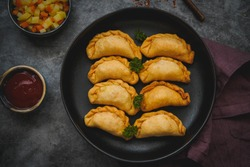 Kue Pastel Goreng filled with carrots, potatoes and eggs, Indonesian Food, Selective Focus
