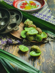 Kuih Cara Manis is a homemade popular tradisional malay of sweet coconut batter with sugar inside. Food concept.