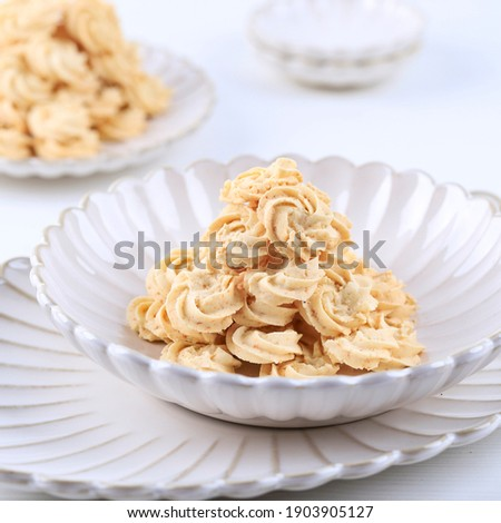 Kukis Sagu Keju or Cheese Sago Cookies is one Favorite Cookies in Indonesia for Christmas or Lebaran. White Concept of Bakery, Copy Space for Text  Сток-фото ©