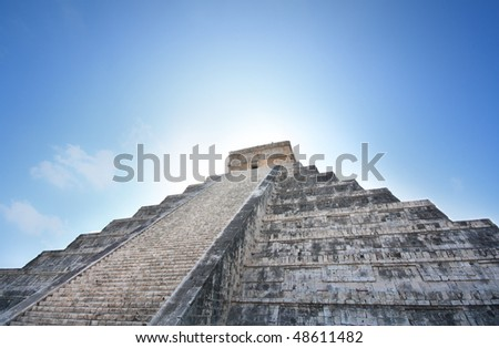 """Kukulcan Mayan pyramid """"El Castillo"""" with the sun rising from behind, Chichen Itza, Mexico"""