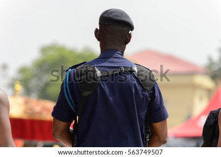 KUMASI, GHANA - JAN 16, 2017: Unidentified Ghanaian policeman at the memorial ceremony dedicated to the Queen mother of the Asante kingdom, who died on Nov 14, 2016 at the age of 111 #563749507