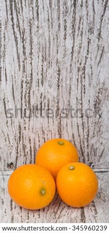Kumquat fruit over wooden background #345960239