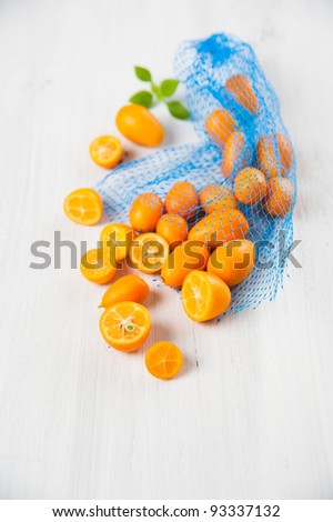 Kumquat Oranges on White