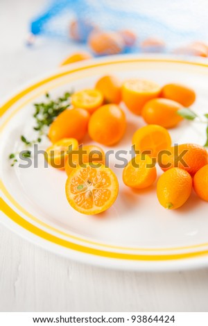 Kumquat Oranges on White Plate