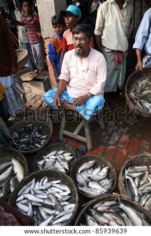 KUMROKHALI, INDIA - JANUARY 12: Selling fish on fish market in Kumrokhali, West Bengal, India on January 12, 2009. Seafood is one of the main source of food for local people.
