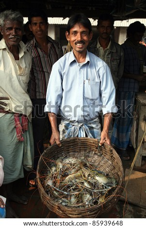 KUMROKHALI, INDIA - JANUARY 12: Selling fish on fish market in Kumrokhali, West Bengal, India on January 12, 2009. Seafood is one of the main part of indian peoples ration.