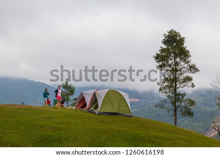 Kundasang, Sabah, Malaysia - 09 October, 2018 : lifestyle of group family enjoying and playing around camping side with nature fresh air - Outdoor travel concept #1260616198