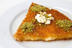 Kunefe is a traditional Palestinian dessert made with cheese pastries soaked in sweet, sugar-based syrup