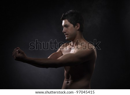 Kung Fu Fighter on the gray background - stock photo