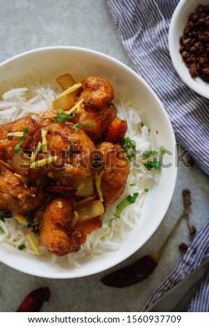 Kung Pao Cauliflower and rice/ Gobi Manchurian,overhead view #1560937709