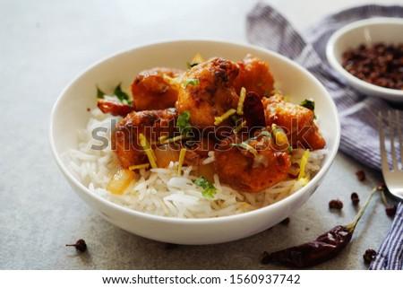 Kung Pao Cauliflower and rice/ Gobi Manchurian, selective focus #1560937742