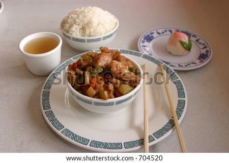 Kung Pow chicken in a Chinese restaurant with rice tea and bean desert