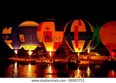 KUNGUR, RUSSIA - JULY 3: Hot air balloons ready to take off at the annual Kungur Hot Air Balloon Fiesta on July 3, 2010 in Kungur, Russia.