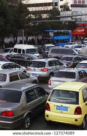 KUNMING, CHINA - FEBRUARY 7: Bottleneck in Kunming CBD. With more than 13 million cars sold in China last year cars are a major factor in China's air pollution. Kunming, Feb. 7, 2013.