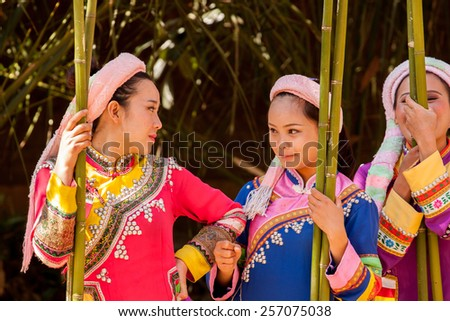 KUNMING,CHINA -  FEBRUARY 15: Lahu women rest after a dance performance in Yunnan Minority Village, Kunming, China, on February 15th, 2015. Lahu people are one of 26 ethnic minorities living in Yunnan