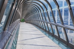 Kupka Bridge covered by roof made of chrome and glass in La Defense business district, Paris, France