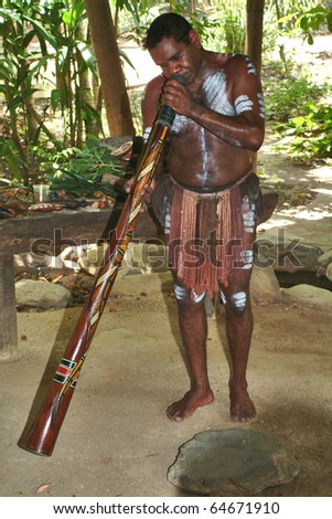 KURANDA, AUSTRALIA - MARCH 01: unidentified aborigines musician does a didgeridoo performance in the Tjapukai Culture Park on March 01, 2005 in Kuranda, Queensland, Australia