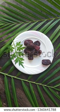 Kurma or Dried Dates Fruit of Ramadhan Food  #1360641788