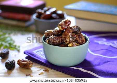 Kurma or Dried Dates Popular During Ramadhan or Fasting Month. Ramadhan food. Selective focus. #1084835915