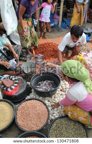 KUTA LOMBOK, INDONESIA - JULY 22 : A woman is selling produce to local customers at Kuta Lombok\'s sunday food market on July 22 2012. The traditional market attracts many from around Kuta Lombok.