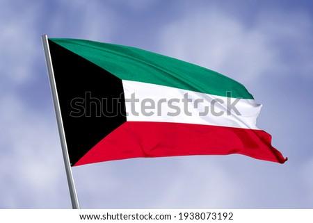 Kuwait flag isolated on sky background. close up waving flag of Kuwait. flag symbols of Kuwait.
