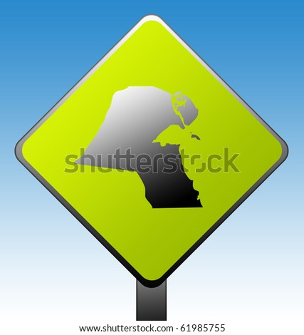 Kuwait green diamond shaped road sign with gradient blue sky background.