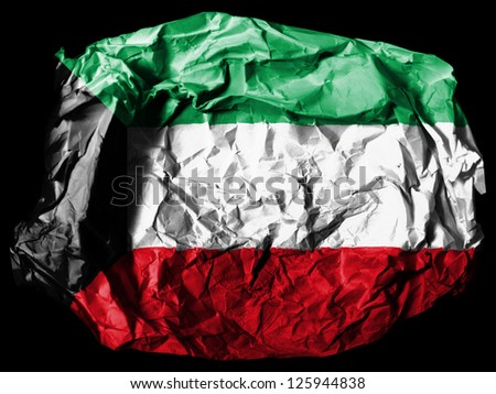 Kuwait. Kuwaiti flag  painted on crumpled paper on black background
