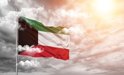 Kuwait national flag cloth fabric on cloud background
