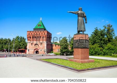 Kuzma Minin monument and Tower of Demetrius (or Dmitrovskaya tower) in the Nizhny Novgorod Kremlin. Kremlin is a fortress in the historic city center of Nizhny Novgorod in Russia. Сток-фото ©