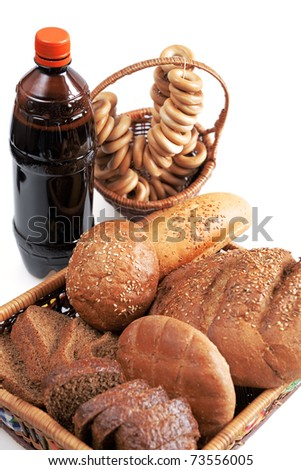Kvass and grain products on a white background