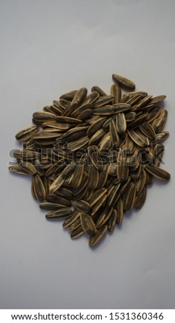 Kwatji is a snack consisting of dried and marinated watermelon seeds, waluh seeds or sunflower seeds.