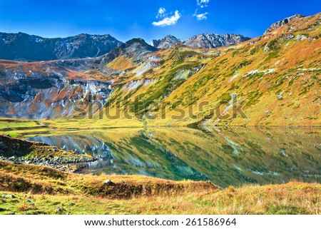 Kyafar lake - one of the biggest in mountains of north Caucasus with panoramic view at the valley. Picture was taken during trekking hike in Caucasia at autumn, Arhiz region,Karachay-Cherkessia,Russia #261586964