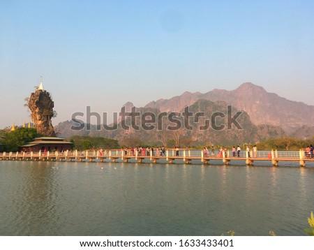 Kyauk Kalap pagoda on a rock, lake, monastery near Hpa-an, Kayin or Karen State, Myanmar  Stock fotó ©