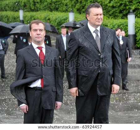 KYIV - MAY 17: Russian President Dmitry Medvedev (L) honors victims of Soviet-era famine with Ukrainian President Victor Yanukovych, May 17, 2010 in Kyiv, Ukraine. - stock photo