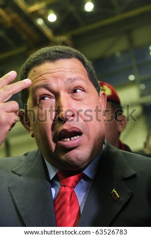 "Kyiv - OCT 18, 2010: President of Venezuela Hugo Chavez during a state visit to Ukraine, on Aircraft Plant ""Antonov"" ASTC, October 18, 2010 in Kyiv, Ukraine."