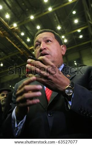 "Kyiv - OCT 18, 2010: President of Venezuela Hugo Chavez during a state visit to Ukraine, on Aircraft Plant ""Antonov"" ASTC, October 18, 2010 in Kyiv, Ukraine."