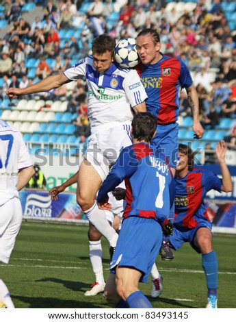 KYIV, UKRAINE - APRIL 23: Andriy Shevchenko of Dynamo Kyiv (L) fights for the ball with Andriy Eshchenko of Arsenal during their Ukraine Championship game on April 23, 2011 in Kyiv, Ukraine