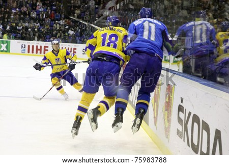 KYIV, UKRAINE - APRIL 23: Dmytro Isayenko of Ukraine (L) fights for a puck with Alexei Vassilchenko of Kazakhstan during their IIHF Ice-hockey World Championship DIV I game on April 23, 2011 in Kyiv - stock photo