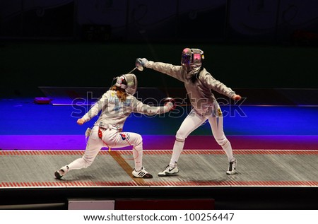 KYIV, UKRAINE - APRIL 13: Ekaterina Dyachenko (Russia) fights against Olena Khomrova (Ukraine) during women's sabre team match of the World Fencing Championships on April 13, 2012 in Kyiv, Ukraine