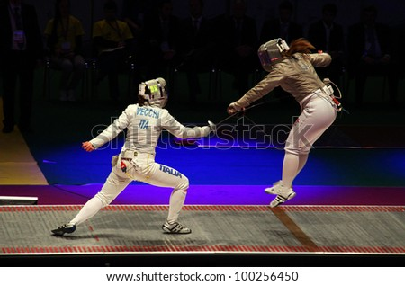 KYIV, UKRAINE - APRIL 13: Irene Vecchi (Italy) fights against Dagmara Wozniak (USA) during women's sabre team match of the World Fencing Championships on April 13, 2012 in Kyiv, Ukraine