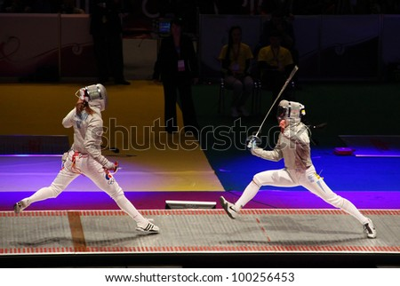 KYIV, UKRAINE - APRIL 13: Yuliya Gavrilova (Russia) fights against Olena Khomrova (Ukraine) during women's sabre team final match of the World Fencing Championships on April 13, 2012 in Kyiv, Ukraine