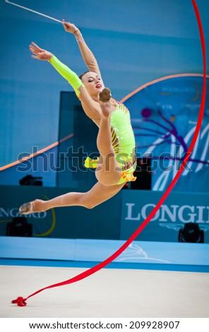 KYIV, UKRAINE - AUGUST 30, 2013: Ganna Rizatdinova of Ukraine performs during 32nd Rhythmic Gymnastics World Championship (Individual All-Around competition)