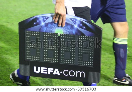 KYIV, UKRAINE - AUGUST 17: Referee takes an indicator board during during UEFA Champions League play-off game between FC Dynamo Kyiv and AFC Ajax on August 17, 2010 in Kyiv, Ukraine